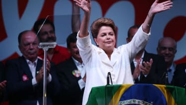 President of Brazil narrowly wins re-election in runoff vote