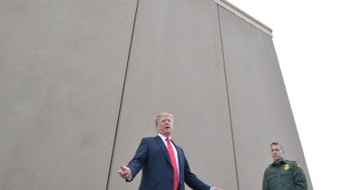 Trump near a border wall prototype