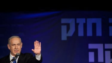 Israeli Prime Minister Netanyahu waves to his supporters at his election campaign headquarters on Jan. 23.