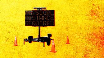 A social distancing sign.