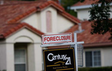 Foreclosure sign at a house.