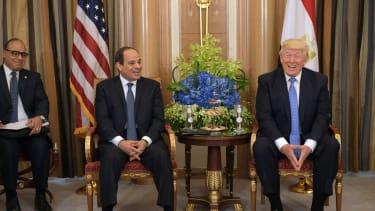 President Trump laughs with Egyptian President Abdel Fattah el-Sisi in Saudi Arabia