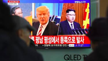 Trump and Kim Jong Un on television.