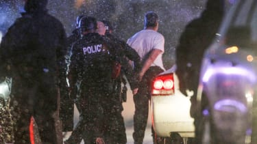 he handcuffed suspected gunman at the Planned Parenthood clinic is moved to a police vehicle in Colorado Springs, Colorado.