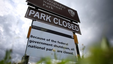 A sign near the entrance to the Everglades National Park is seen indicating it is closed on October 7, 2013 in Miami, Florida