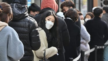People wear masks in South Korea.