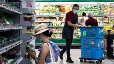 Grocery store worker in Singapore