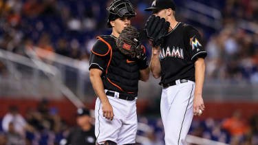 Marlins catcher J.T. Realmuto speaks with pitcher Adam Conley on the mound.