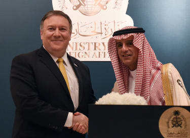 Saudi Foreign Minister Adel al-Jubeir (R) shakes hands with US Secretary of State Mike Pompeo