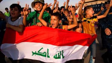 Children celebrate the liberation of Mosul.