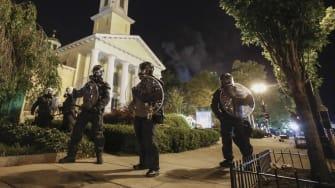 Police officers outside of St. John's Church.