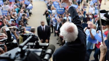 Bernie Sanders greets a crowd of supporters.