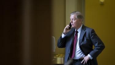 Lindsey Graham on his phone