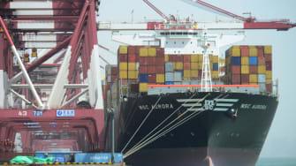 A cargo ship loads up in Qingdao, China.