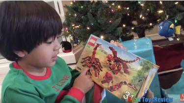 Ryan of Ryan ToysReview opens a Lego box.