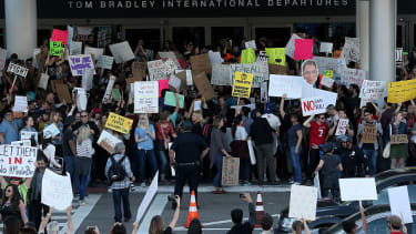 Demonstrators flock to LAX to protest against the immigration ban.