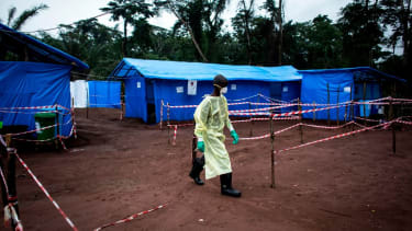 A health care worker helping Ebola patients in 2017.
