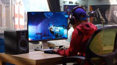 A boy playing video games.