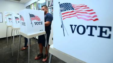 A man votes.