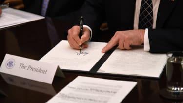 President Trump signs executive order.