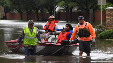 Houston residents are evacuated from Tropical Storm Harvey flood waters by volunteers.