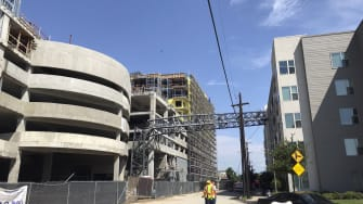 A crane crashed through this Dallas apartment building on Sunday.