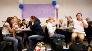 Students at a Utah high school eat during Mix it Up at Lunch Day on Oct. 18, 2011.
