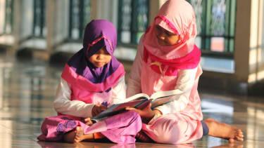 Children reading a book.