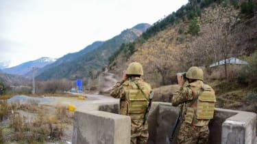 Pakistani troops watch Indian troops in Kashmir
