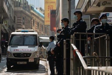 Hong Kong police arrest democracy advocates