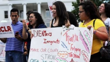 Immigration activists gather in front of the White House on June 15 to celebrate the Obama Administration's announcement that it will stop deporting young illegal immigrants. A new Bloomberg