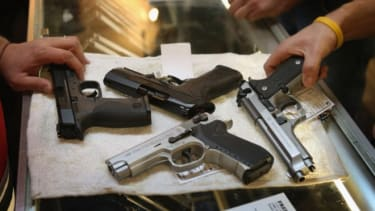 A customer shops for a new gun at a sporting goods store in Illinois on Jan. 19.