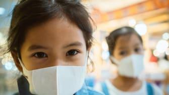 Kids wearing masks.