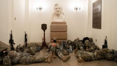 National Guard troops rest in U.S. Capitol.