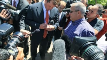 Roger Clemens signs a baseball outside the courthouse, after his case was declared a mistrial Thursday.