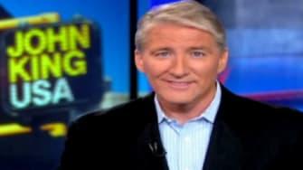 "John King, the man behind the ""Magic Wall,"" takes Lou Dobbs's place on CNN."
