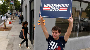 A Netflix employee promotes a character from House of Cards outside a polling station.