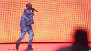 Kanye West stops show, demands wheelchair-bound fan 'stand up'