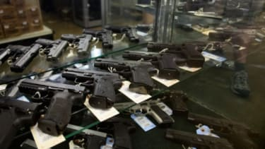 Hand guns seen on display for purchase.