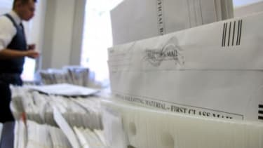 Milwaukee Election Commission staffer Marcelo Guardiola sorts absentee ballots on Nov. 5 in Wisconsin.