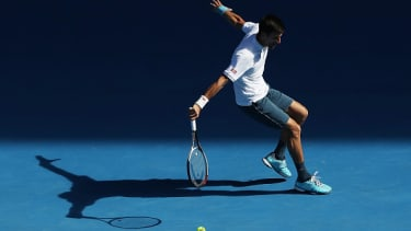 Novak Djokovic plays a backhand against Denis Istomin.