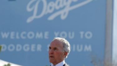 Los Angeles Dodgers owner Frank McCourt is trying to hang onto his baseball team by filing for bankruptcy.