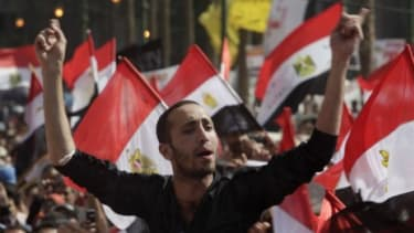 A protester chants in Tahrir square