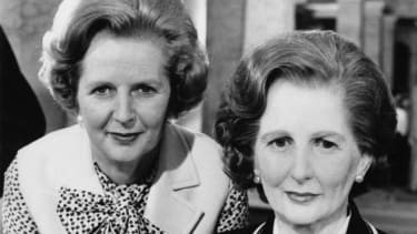 A tale of two Thatchers: The Prime Minister poses with her wax self in 1980.
