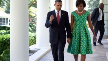 Michelle Obama wears a Barbara TFank dress in September. A First Lady appearance can be worth, on average, $14 million for a clothing company.