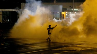 One shot, others arrested as Ferguson protests slip back into chaos