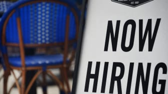 "A restaurant displays a ""Now Hiring"" sign amid the coronavirus pandemic, on August 4, 2020 in Arlington, Virginia."