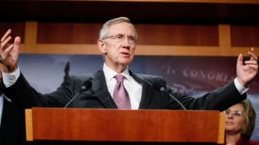 A senior adviser to Harry Reid invested in a renewable-energy firm that benefited from legislation the senator passed.