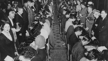 Immigrants register in a New York post office in 1940 to prove they are not subversive agents.