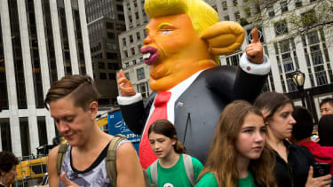 An inflatable rat that looks like Donald Trump.